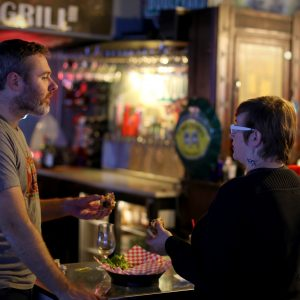 Patrons ordering drinks at Helen's North Kansas City dive bar
