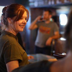 Friends sharing conversation at Helen's North Kansas City dive bar